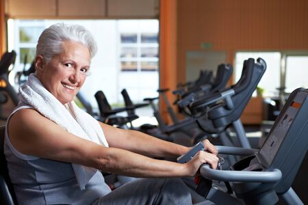 Happy smiling senior woman exercising in a gym Stock Photo - 8128565