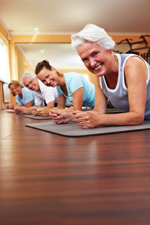 Happy group in a gym doing Pilates photo