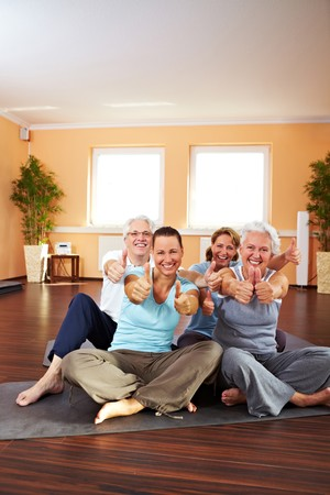 Happy group in a gym holding their thumbs up Stock Photo - 8209777