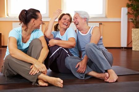Three happy women sitting in a gym Stock Photo - 8209783