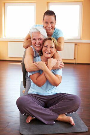 senior friends: Three happy women sitting in a gym