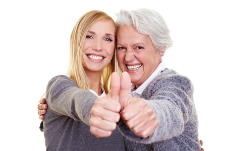 Happy grandma and her granddaughter holding their thumbs up Stock Photo - 8286548