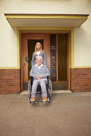 Happy disabled woman in wheelchair in assisted living photo