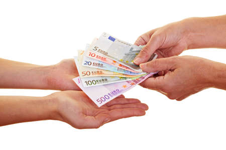 Two hands claiming many european money banknotes photo
