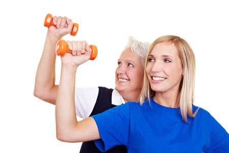 Two happy women training with small dumbbells Stock Photo - 8286965
