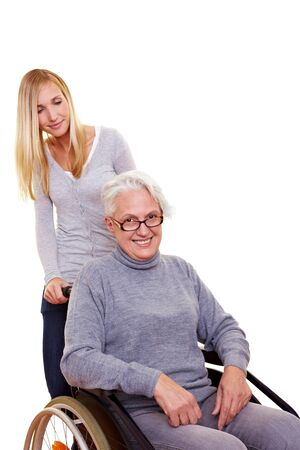 paraplegia: Granddaughter driving her happy grandmother in wheelchair