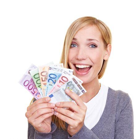 dinero euros: Joven sonriente celebraci�n de ventilador hecha de dinero de euro