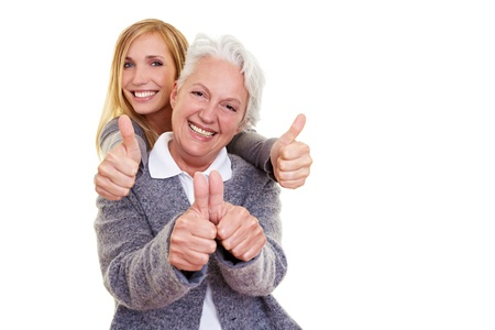Happy grandma and her granddaughter holding their thumbs up Stock Photo - 8287054