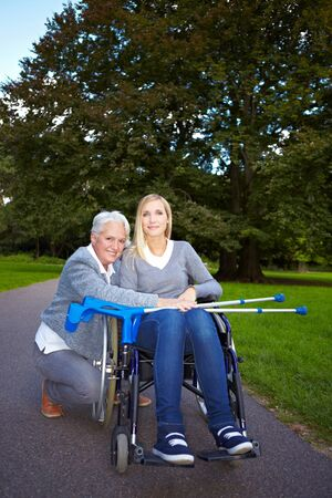 Happy grandmother with handicapped grandchild in a park photo