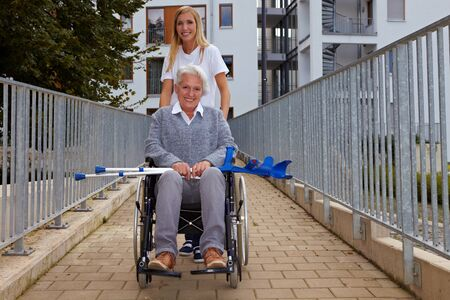 Happy woman in wheelchair on a ramp photo
