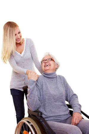 Young woman reaching out to an elderly handicapped woman Stock Photo - 8287065