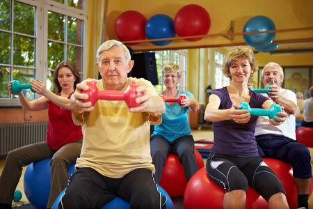 Group working out with dumbbells in gym Stock Photo - 8347363