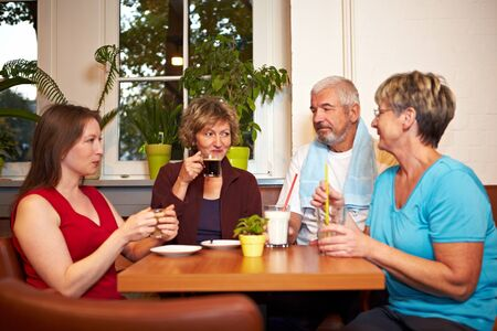 Mixed group drinking coffee in a gym Stock Photo - 8347357