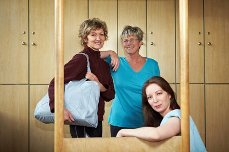 gym dress: Three happy woman smiling in changing room