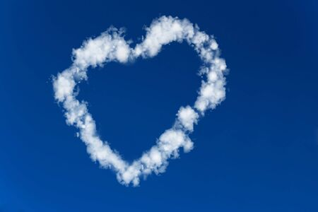 Heart made of clouds in a blue sky photo