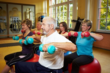 Group working out with dumbbells in gym Stock Photo - 8413954