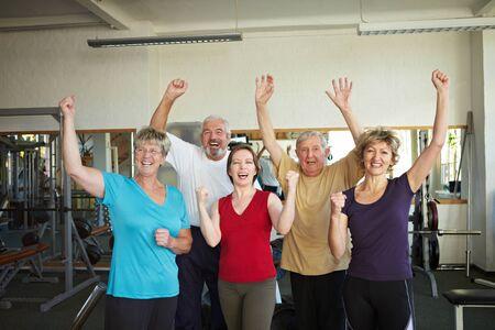 Group of elderly people having fun in gym photo