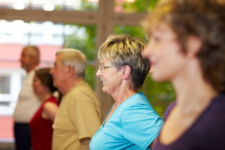 Fitness training for seniors in a gym photo