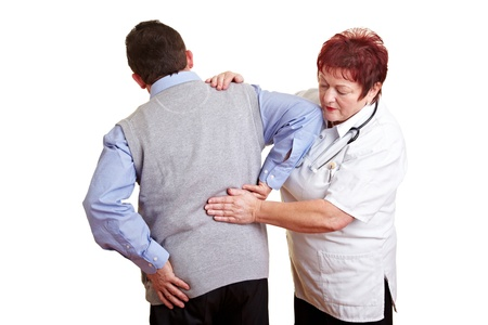 senior pain: Man with back problems seeing a female doctor Stock Photo