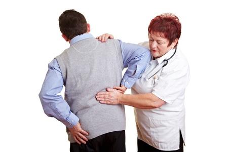 elderly pain: Uomo con problemi di schiena vedendo una dottoressa Archivio Fotografico