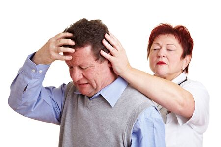Man with migraine seeing a doctor for an examination photo