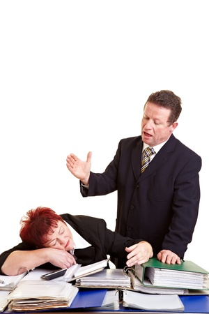 admonish: Boss ranting over a sleeping employee on a desk