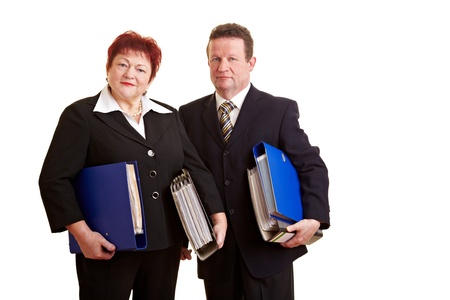 Two happy elderly business people carrying files photo