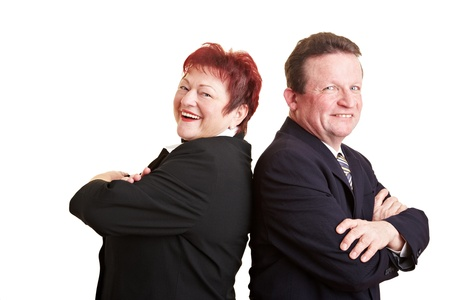 Two smiling elderly business people with arms crossed photo