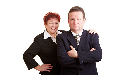Portrait of two happy elderly business people photo