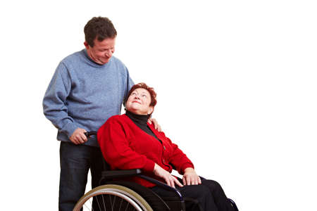 Male nurse caring for disabled senior woman in wheelchair photo