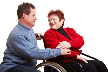 Elderly man caring for his senior woman in wheelchair Stock Photo - 8597897