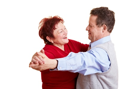 senior citizens: Two happy senior people dancing a waltz