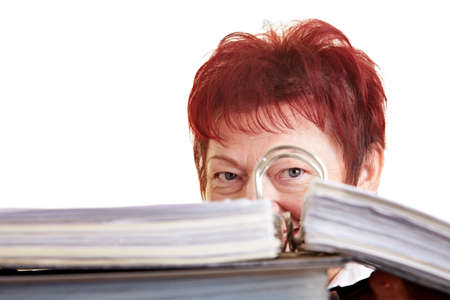 Elderly business woman hiding behind her files photo