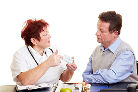 adverse: Female doctor explaining side effects of medication to a patient Stock Photo