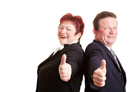 Two happy elderly business people holding thumbs up photo