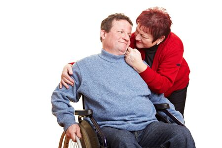 Senior woman caring for her man in wheelchair Stock Photo - 8621346