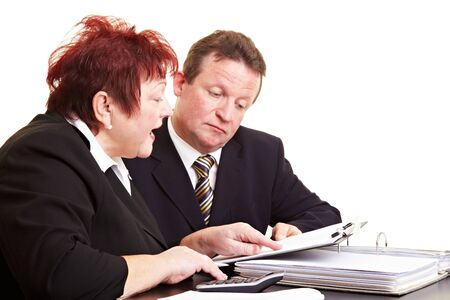 investment strategy: Two senior people discussing a financial investment strategy