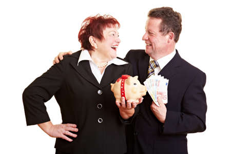 Happy senior couple with piggy bank and Euro money photo