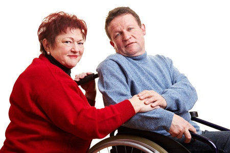 Elderly couple with man sitting in wheelchair photo