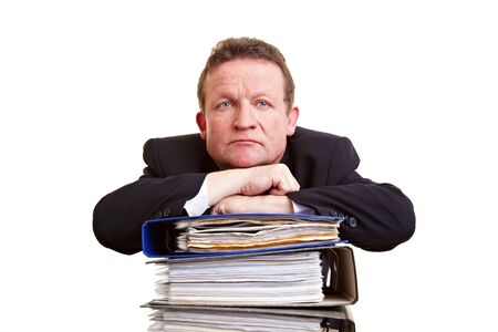 senior business: Frustrated senior business man with stack of files Stock Photo