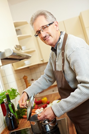 Housemaker in the kitchen cooking lunch on a stove Stock Photo - 8903580