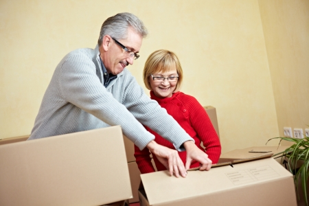 Two happy senior people with many moving boxes Stock Photo - 8903620