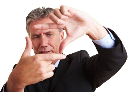 Senior manager making a frame with his fingers Stock Photo - 8903649