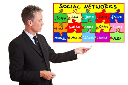 Senior business man explaining social networks with a chart photo