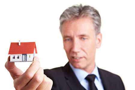 Architect holding a small house in his hand Stock Photo - 8903636