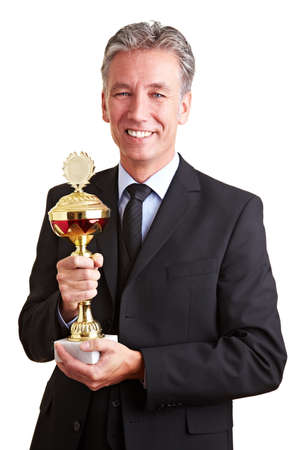 Happy senior business man holding a trophy in his hands photo