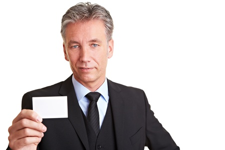 Senior business man holding an empty white business card photo