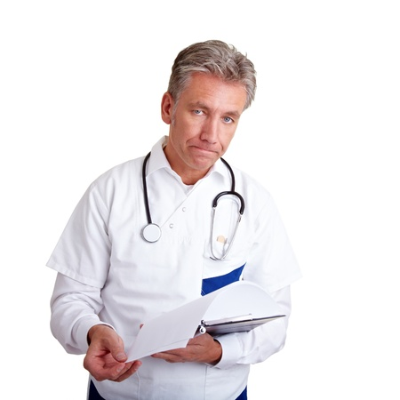 Doctor with a clipboard trying to deliver bad news photo
