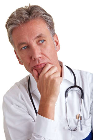 physician: Thoughtful senior physician thinking with hand on his chin