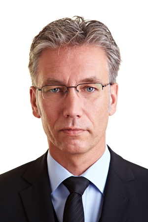 frontal portrait: Portrait of a serious business man with glasses Stock Photo